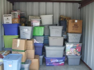 New Bern  Self Storage Auction #104328 - Image 1 books,boxes / totes,clothing,holiday decor,toys / baby items