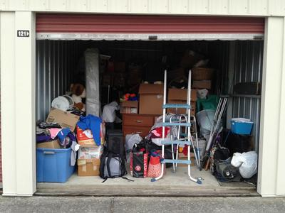Lexington  Self Storage Auction #69572 - Image 5 bedding,boxes,clothing,dishes,electronics,Holiday Decor,kitchenware,lamps,mattress