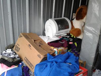 Lexington  Self Storage Auction #69572 - Image 3 bedding,boxes,clothing,dishes,electronics,Holiday Decor,kitchenware,lamps,mattress