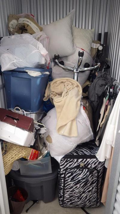 Wixom  Self Storage Auction #90575 - Image 3 bedding,clothing,office equipment