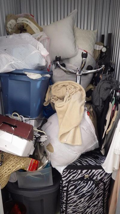 Wixom  Self Storage Auction #90575 - Image 2 bedding,clothing,office equipment