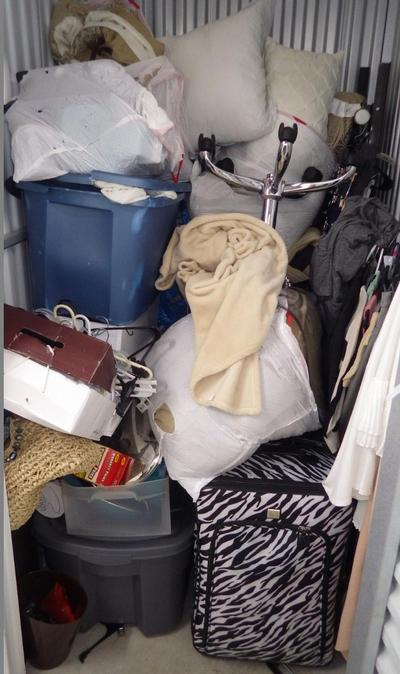 Wixom  Self Storage Auction #90575 - Image 1 bedding,clothing,office equipment
