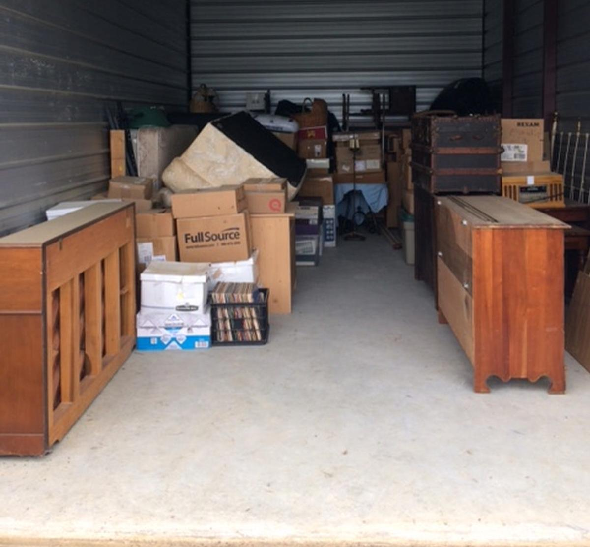 Starkville  Self Storage Auction #82575 - Image antiques,boxes,furniture,shelves